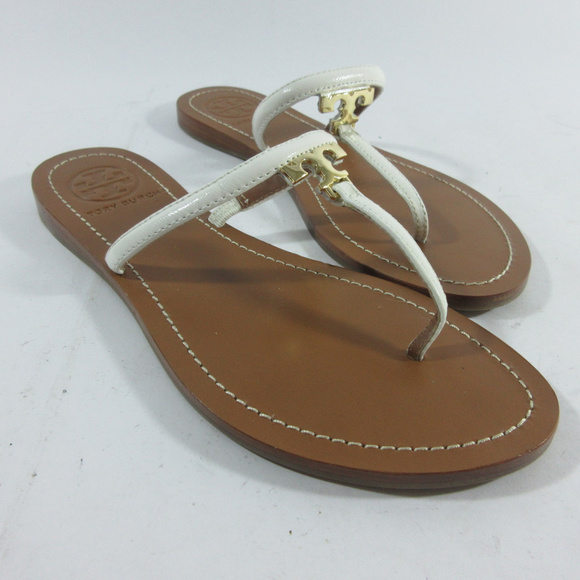 8d01873fa Tory Burch Gold T Logo Flip Flop Thong Sandals. M 5b020f7284b5cee1bb0d7b40.  Other Shoes you may like